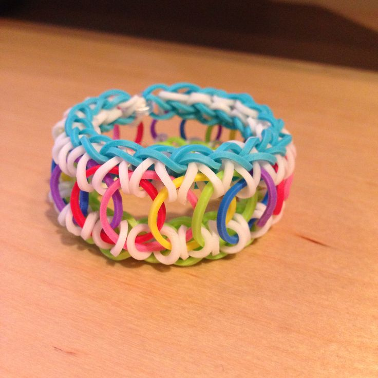 Overlapping circle rainbow loom cuff in a rainbow pattern.  (With green grass and a blue sky, too, ha ha!)