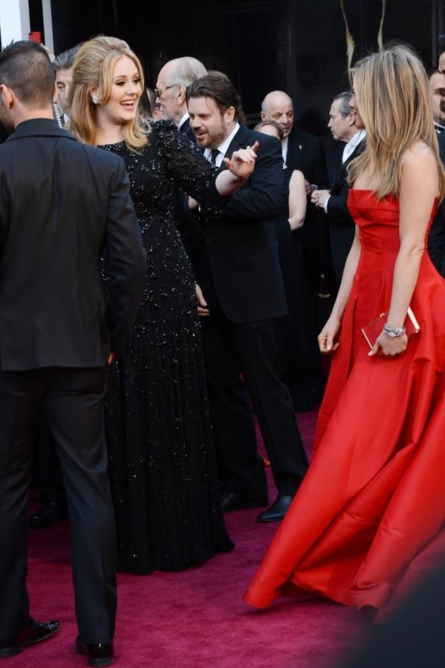 Adele (dressed in jet embellished Burberry) gave Jennifer the shaka sign! Hang loose, innit.  Jennifer Aniston is a big fan of visiting the Islands
