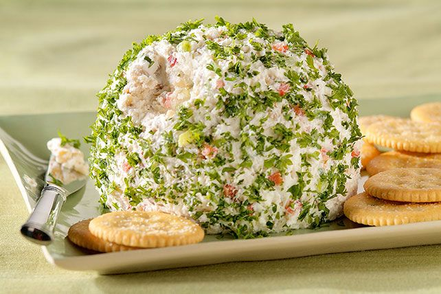 Green onions and red peppers add festive color to this feta and cream cheese ball. Walnuts give it a tasty bit of crunch.