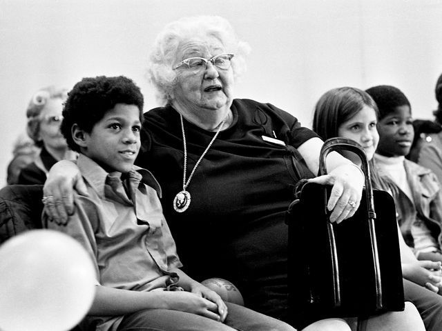 "Foster grandmother Mrs. Winifred DuMont, right, and her ""grandchild"" Harry Dickerson enjoy the program during the annual Grandparent program Christmas program at the senior citizensÕ Knowles Center Dec. 17, 1974. Frank Empson / The Tennessean"