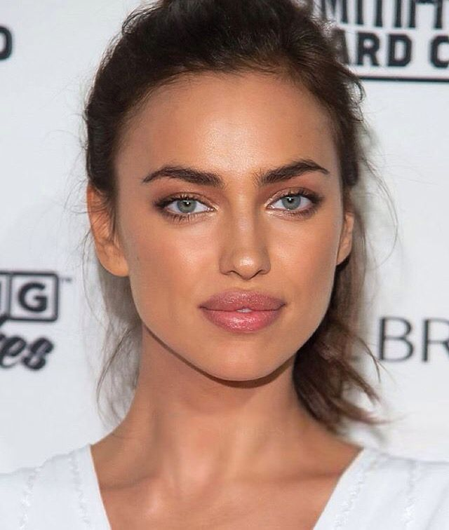 Irina Shayk stuns with natural bronzed skin, minimal makeup and perfect pout.