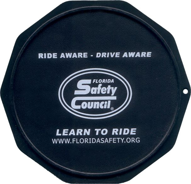 This is a sample of a Custom Imprinted Motorcycle Coaster®. This is one we printed for the Florida Safety Council.  Check them out at FloridaSafetyCouncil.org. The Motorcycle Coaster® is sometimes referred to as a kickstand pad, kickstand plate, side stand pad, side stand plate, or puck.   It is specifically designed as a motorcycle kickstand support aide for soft surfaces and is designed for your custom printed message.