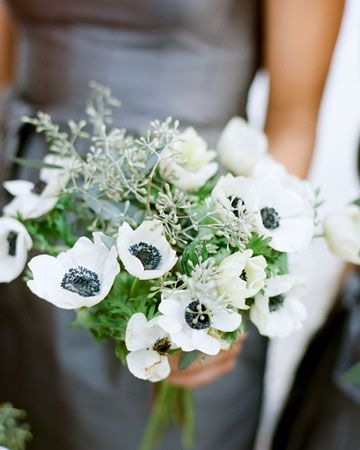 A bridesmaid bouquet of seeded eucalyptus and anemones