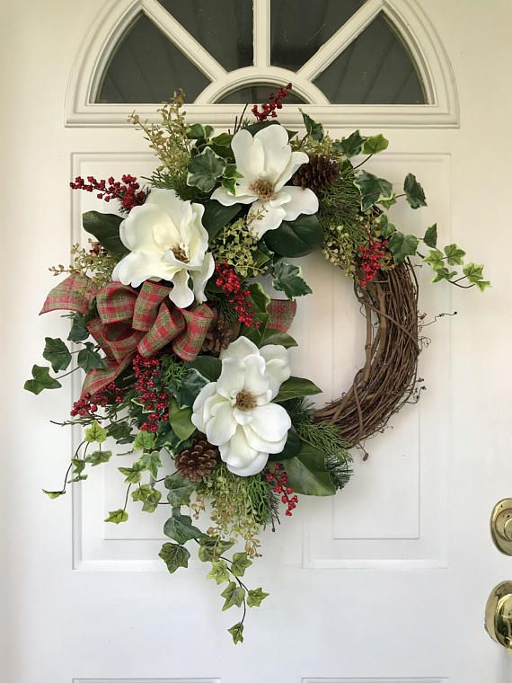 Add a southern-inspired touch of hospitality to your home this holiday season with this lovely magnolia and foliage wreath that is perfect for the whole winter season. The beautiful white blossoms are complemented by a mix of coral and English ivy, magnolia leaves, wisteria, pine and