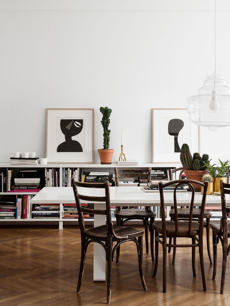 Casual Modern Dining Room with low bookcase