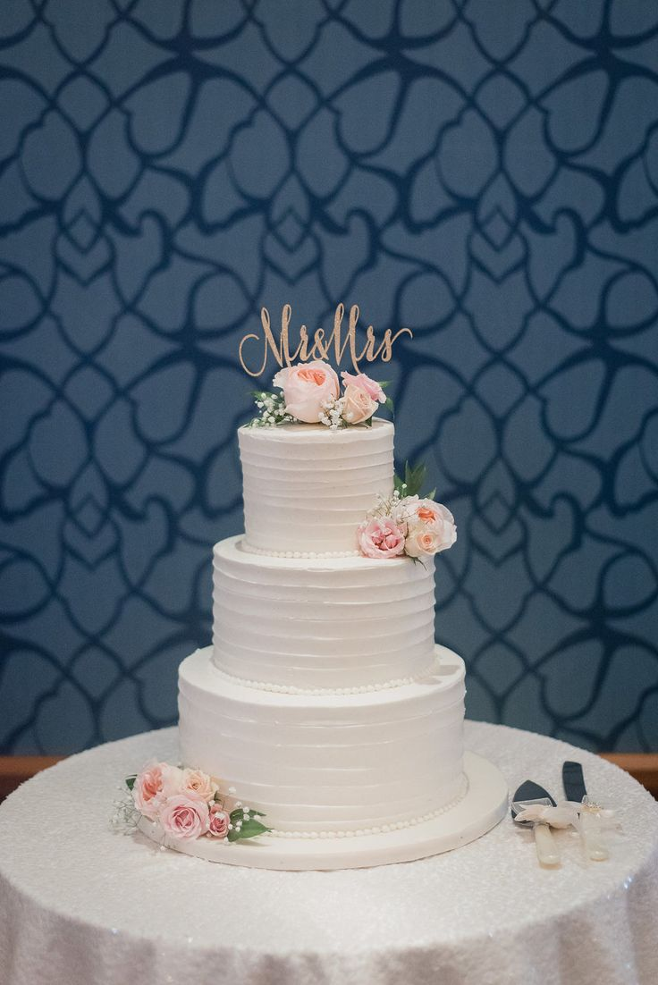 August 2015 | Milton ON | www.kjandco.ca | KJ and Co. planning, coordination and design at Stephanie & Mike's Glencairn Golf Club wedding | Photo by Jenn Kavanagh Photography | As seen on TheBlackTieBride.com | three tier white wedding cake accented with flowers and a gold glitter Mr and Mrs cake topper