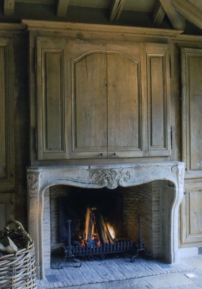 Decorating Around The TV   20 Elegant, Inspiring Ideas - laurel home   beautiful stone fireplace mantel and TV concealment by Amy Howard #hidetheTV