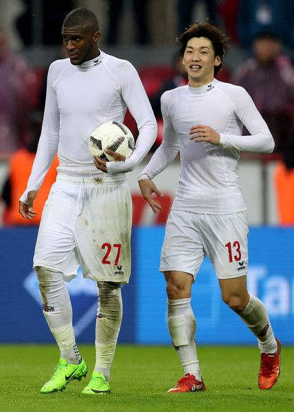 Anthony Modeste of Koeln is seen with the ball net to Yuya Osako of Koeln  during the Bundesliga match between 1. FC Koeln and Hertha BSC at RheinEnergieStadion on March 18, 2017 in Cologne, Germany.