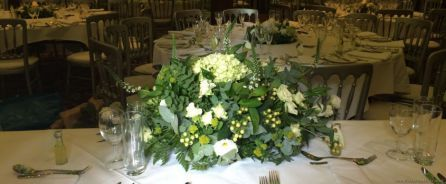 Ivory and Green Long and Low Top Table Arrangement Just Picked Wild Wedding Back View at Alicia Hotel | Wedding Flowers Liverpool, Merseyside, Bridal Florist, Booker Flowers and Gifts, Booker Weddings