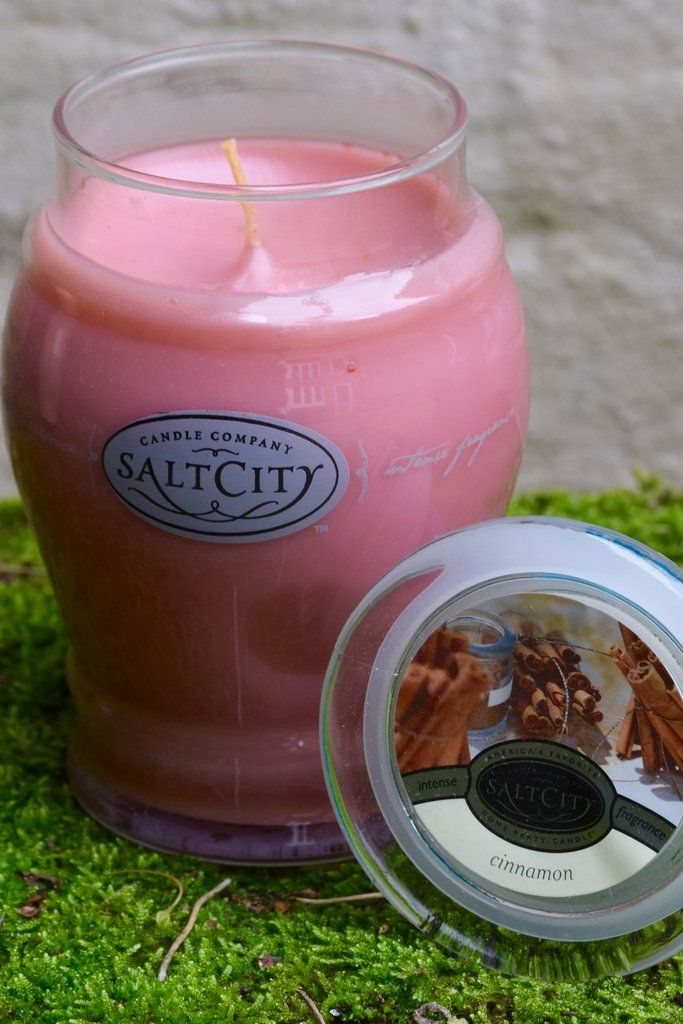 SALT CITY CANDLE - CINNAMON 26OZ Cinnamon One of the most easily recognizable aromas, our Cinnamon scented candles will fill your home with the warm, pungent, and energizing scent of cinnamon. Reminiscent of crisp fall evenings and the holiday season, the smell of freshly ground cinnamon bark will permeate any room to create a cozy, warm and inviting atmosphere. The perfect complement to a roaring fire and a warm cup of cocoa. Cinnamon scent notes feature: ground cinnamon and nutmeg.