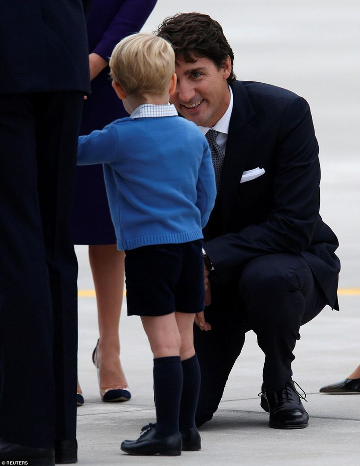 The Prime Minister of Canada Justin Trudeau, kneels to talk to Prince George at Victoria International Airport on September 24, 2016 in Victoria, Canada.