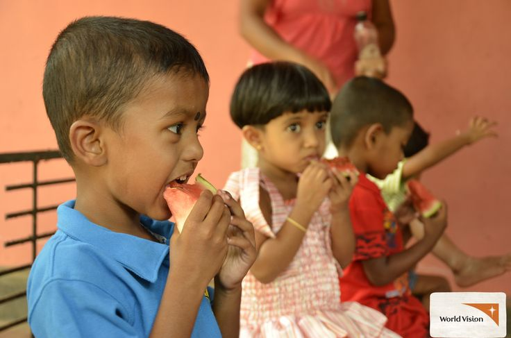 Yum, #watermelon! These kids are enjoying a healthy snack at a #nutrition project in #SriLanka, while their mothers learn about nutrient rich foods they can feed their families. Almost all the children in the village used to be underweight – but thanks to the project things are starting to change. Photo by Hasanthi Jayamaha, #WorldVision