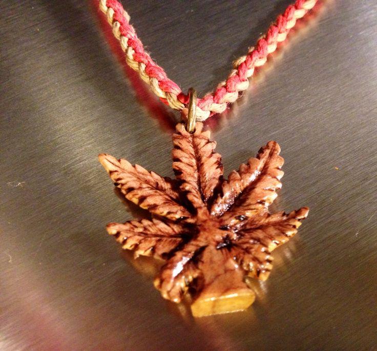 Custom order I carved out of olive wood. Pot leaf/marajuana leaf necklace pendant..  SOLD $50