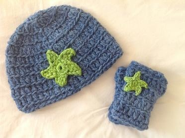 Star beanie and wrist warmers in blues brights.