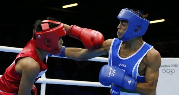 Mark Barriga (L) of the Philippines and Manuel Cappai (R) of Italy exchange blows during their Light Flyweight (49kg) boxing match of the London 2012 Olympics at the ExCel Arena July 31, 2012 in London. Barriga was awarded a 17-7 points decision. AFP PHOTO / Jack GUEZ (Photo credit should read JACK GUEZ/AFP/GettyImages)