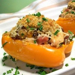 Green bell peppers are filled with ground beef, cooked rice, tomato sauce, and seasonings, then baked for an hour with additional tomato sauce and Italian-style seasoning.
