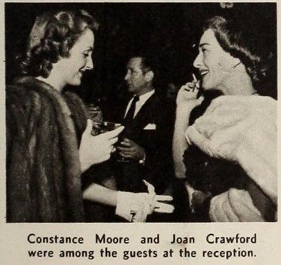 Joan Crawford: Screenland (April 1949).  Joan and Constance Moore at the wedding reception of Marguerite Chapman and Bentley Ryan at the Bel-Aire Hotel.
