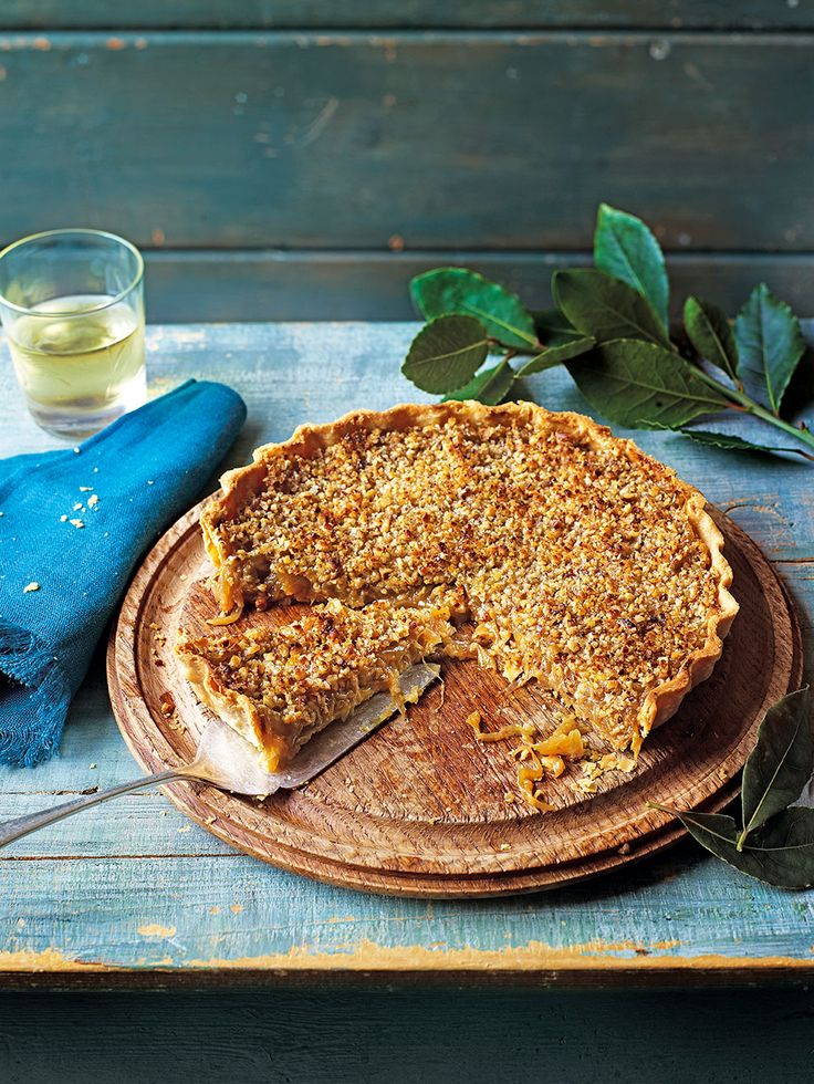 Sweet, slow cooked onions make this vegetarian tart recipe a real treat. The walnut crust adds texture.