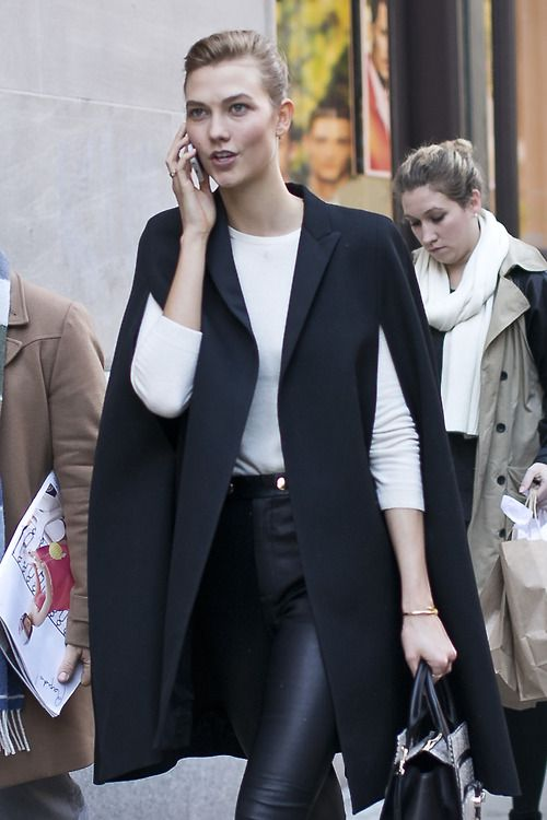 Karlie Kloss killing it during New York Fashion Week in a classic cape coat and…