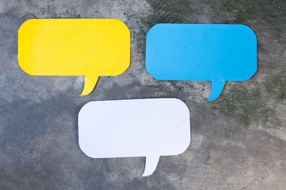 Three of Yellow, Blue and White Speech Bubbles Over Gray Grunge Background - Balloon speech bubble concept @creativework247