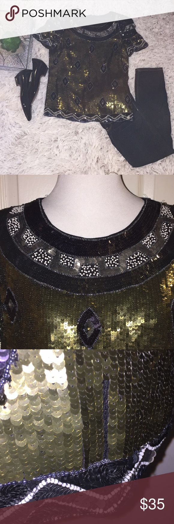 French Connection Sequin Beaded Top Gold & Black A Beautiful and Regal Detailed Fully Sequined and Beaded Top. Size 6. Lightly Padded Shoulders. 3/4 Zipper Back. Fully Lined. A Small Area on Left bottom Missing a few Sequins (see 3rd pic) but not noticeable IMO as blouse is so ornate. Pair with Leather Leggings and Heels or with Jeans and Boots. French Connection Tops Blouses