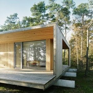 This wooden summerhouse raised off the forest floor on three concrete beams was designed by architect Johan Sundberg for a patch of woodland by the Swedish coastline