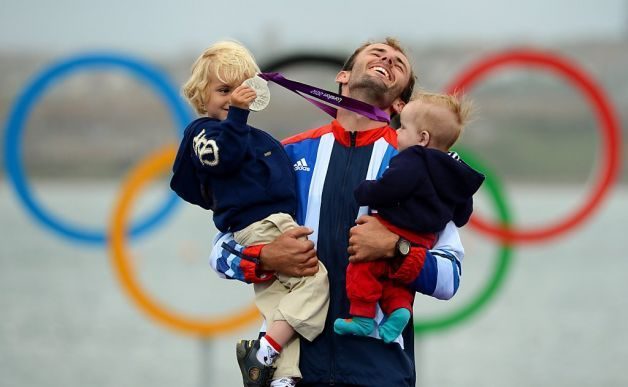 Britain's Nick Dempsey poses with his sons Thomas-Flynn and Oscar after he won silver in the men's RS:X sailing class at the London 2012 Olympic Games, in Weymouth on August 7, 2012.