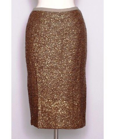 "As seen on ""CityLine""! Dazzling version of the pencil skirt with sequins all-through. This amazing skirt is great for the office as well as for a formal event. Pair it with our ""All Those Pleats"" top, a beige belt and nude pumps for the perfect look."