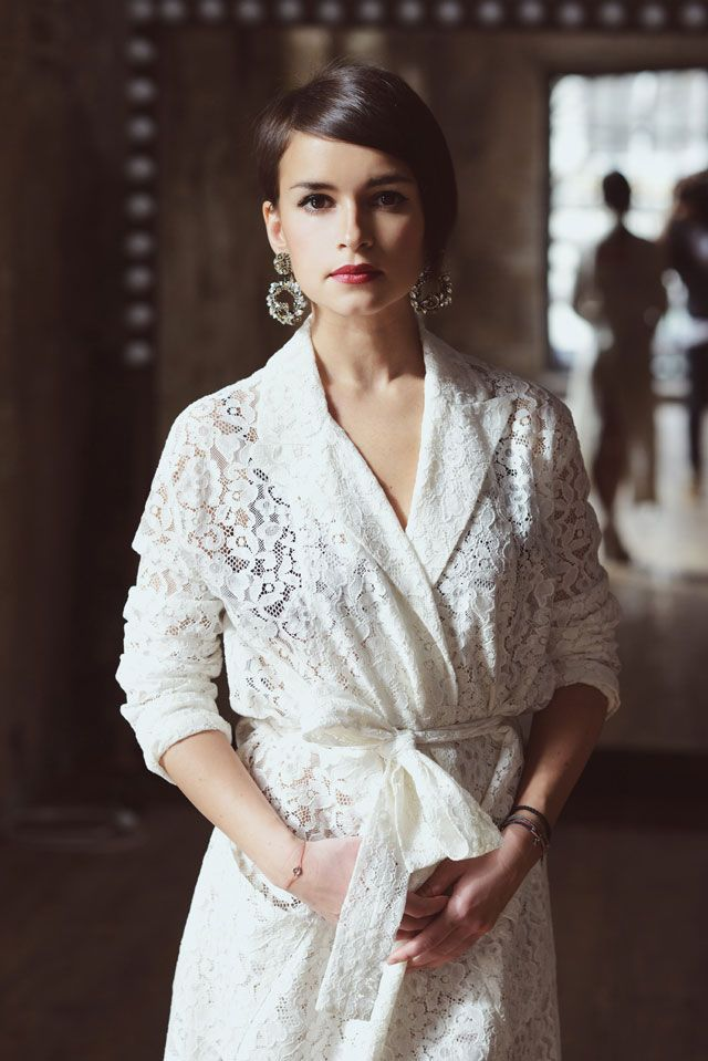 Miroslava Duma is wearing a lace bathrobe trench with ginormo earrings and it's amazing.:
