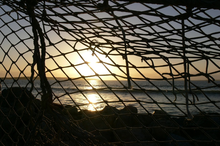 Sunset through a fishing net