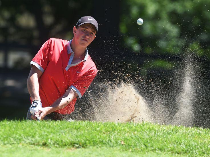 Garret Jensen hits a chip shot on No. 11 at Veenker Memorial Golf Course on Sunday. Jensen finished third in the Ames city golf tournament. Photo by Nirmalendu Majumdar/Ames Tribune