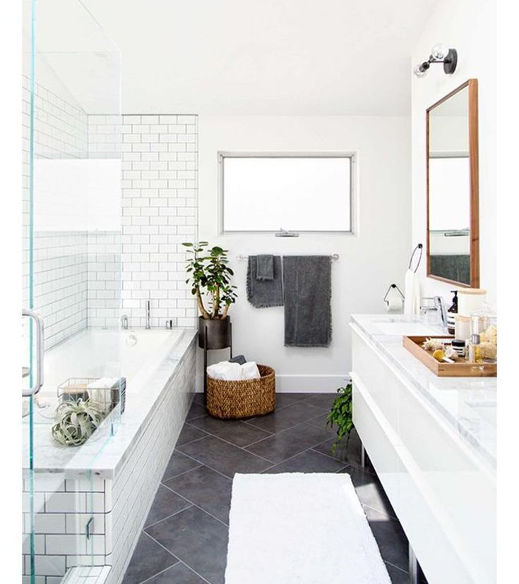 Pinning this morning and came across this simple, cool + timeless bathroom.  Also some