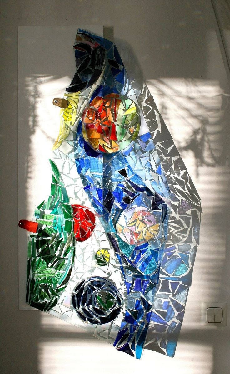 Recycling art.  Old car window with colored glass