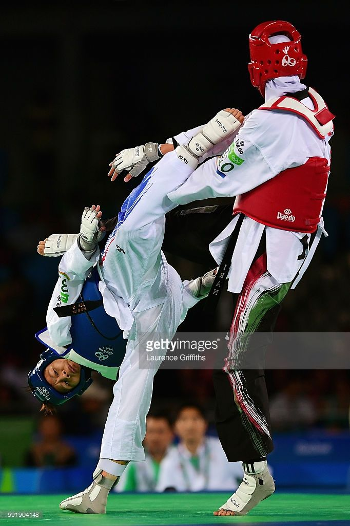 Phannapa Harnsujin of Thailand competes against Kimia Alizadeh Zenoorin of the Islamic Republic of Iran during the Women's -57kg Repechage Taekwondo contest at the Carioca Arena on Day 13 of the 2016 Rio Olympic Games on August 18, 2016 in Rio de Janeiro, Brazil.