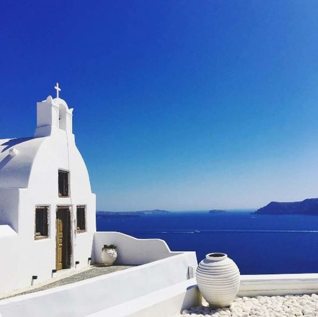 #Santorini #Greece for rugged landscape and whitewashed buildings #GreekIslands #AegeanSea #honeymoon #sparrowweddings