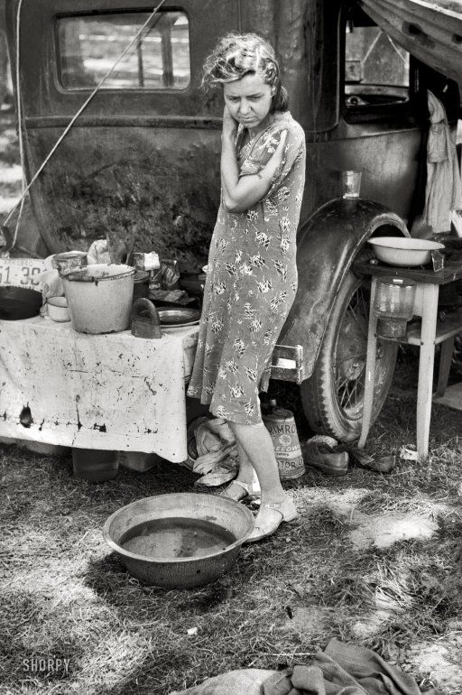 """July 1940. Berrien County, Michigan. """"Migrant mother of family from Arkansas in roadside camp of cherry pickers."""""""