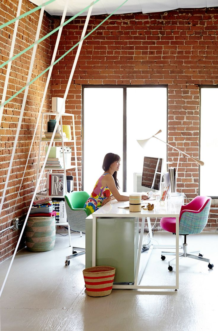 Exposed brick + open shelving + colorful striped baskets | Office of Joy Cho of Oh Joy!