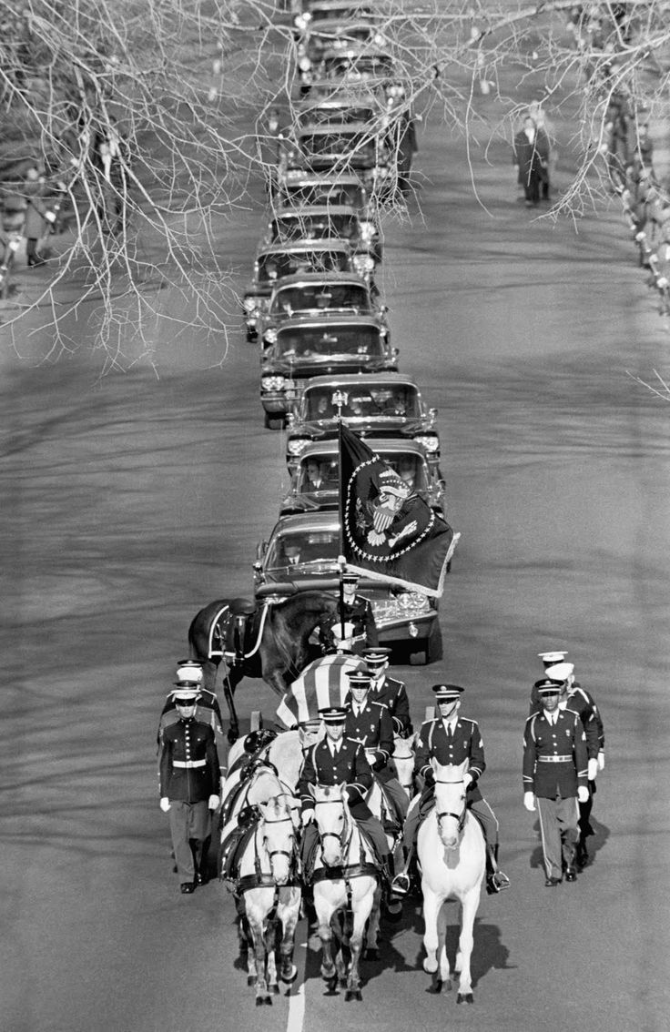 Funeral of President John F. Kennedy, Nov 25, 1963. To pay respect, 800,000 lined streets to watch coffin's procession. The procession included a caparisoned horse - a riderless horse with boots facing backwards in the saddle.