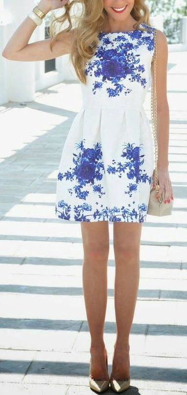 White with blue floral accents a-line pleated dress.