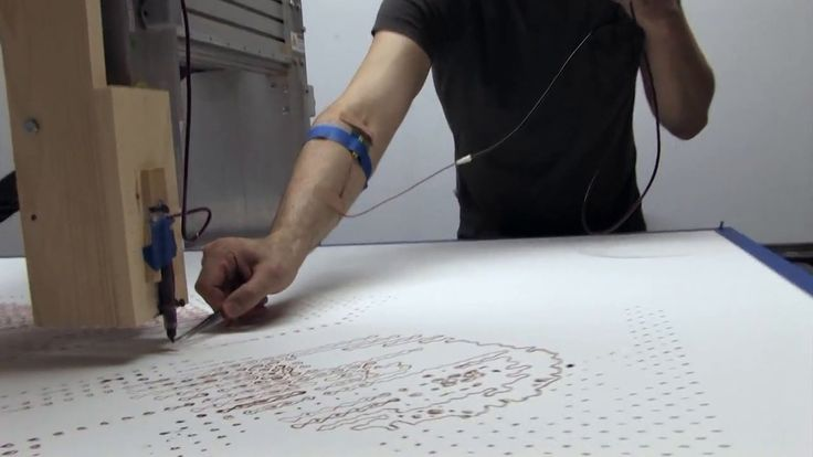 Artist Ted Lawson creates a life-sized self-portrait drawing, in his own blood, using a robot.