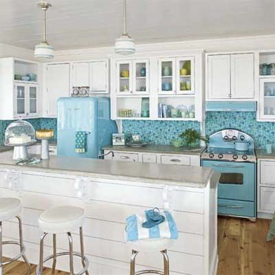 white and blue kitchen with island, blue tile, blue appliances and stools