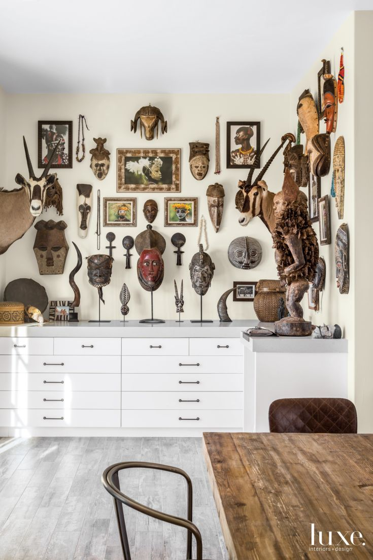 Traditional kitchen seattle by canyon creek cabinet company - Tribal Masks And Artwork From The Homeowners Collection Are Hung En Masse Above Streamlined Custom Cabinet Companiesafrican