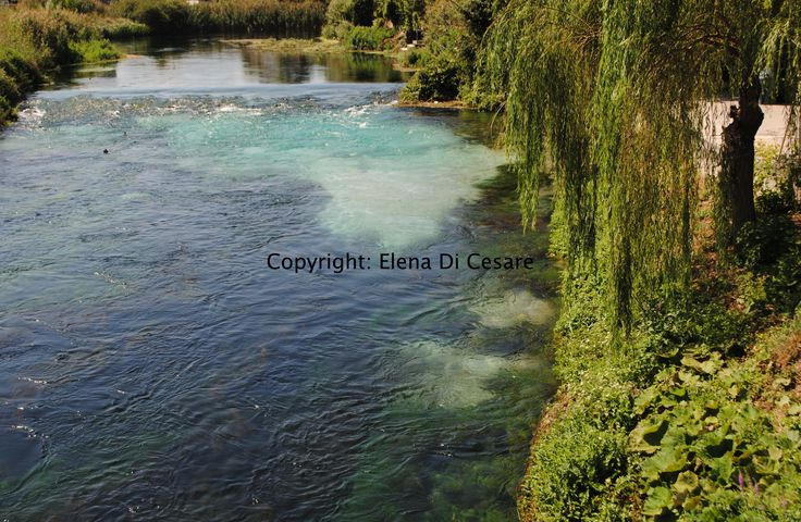 The African continent, in turquoise hues, appears mysteriously in the waters of the Pescara river - Abruzzo, Italy.