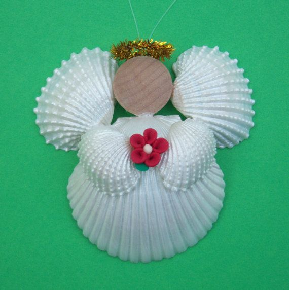 120 best shell angels and crafts images on pinterest for Seashell ornament ideas