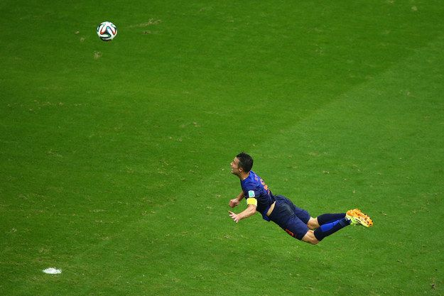 """AMAZING!!!!!!    FIFA World Cup Brazil  2014 on CBC Sports - Video on demand Highlights: Netherlands 5 ,Spain 1 June 13 Holland's Robin Van Persie leapt into the air to head. """"Click"""" on the image photo to see the Video.  The flying Dutchman!  13.6. 2014. NCO eCommerce, www.netkaup.is"""