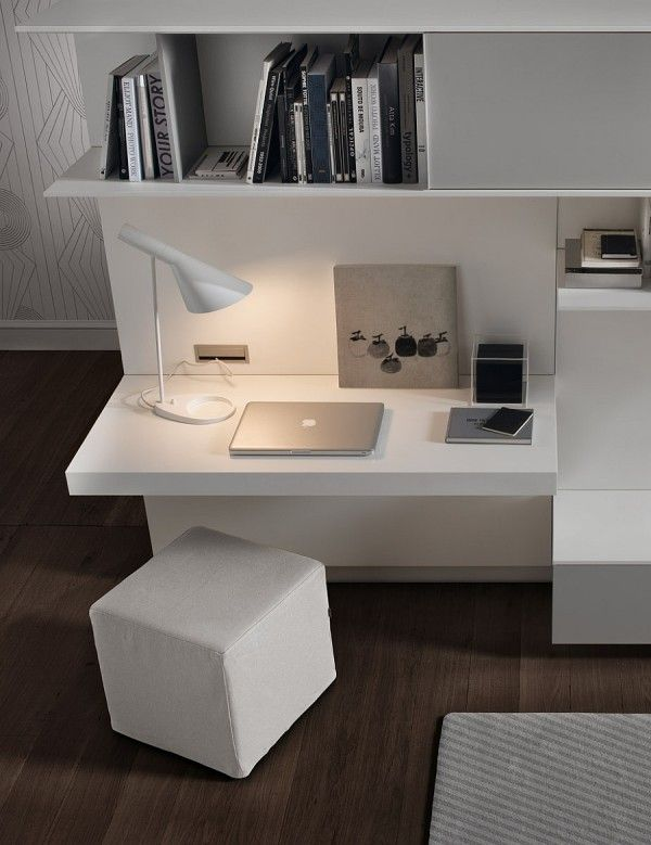 Chic Workspace With A Built In Desk And Cube Ottoman For The Living Room