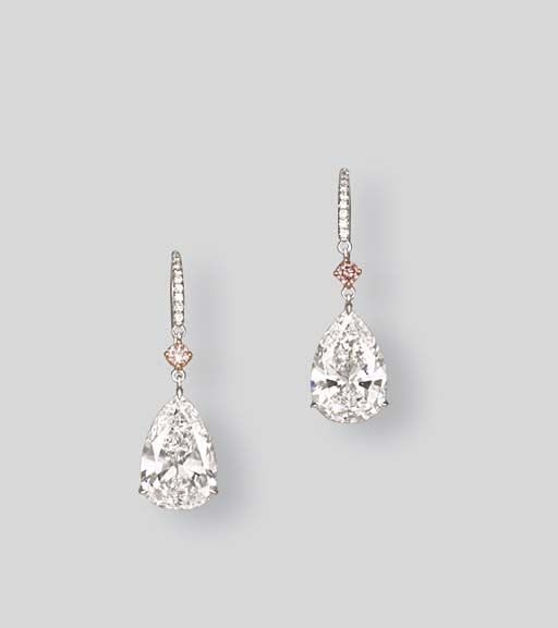 A PAIR OF DIAMOND EAR PENDANTS  Each set with a pear-shaped diamond weighing 3.01 and 3.07 carats suspended by a brilliant-cut pink diamond surmount with a diamond hook, mounted in 18k pink and white gold, 3.0 cm long