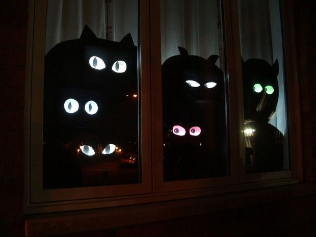 The glowing eyes follow you as you walk down the street. A spooky effect that is cheap and easy to make! Put one in every window for a really creepy effect! Made from cereal boxes, cardboard, and paper mache.
