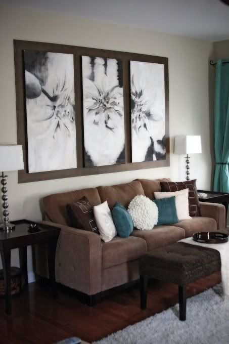 brown, cream, teal blue living room. The wall art over the couch is nice with the single frame.