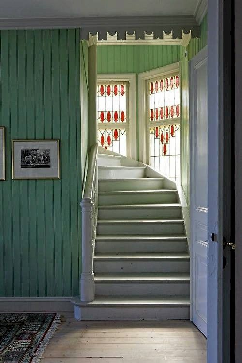 Lovely stairwell in a Swedish home. I love the molding at the top of the door. Klas Sjöberg photo